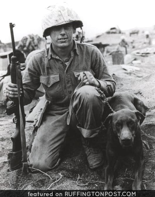 Private Francis M. Hall and Doberman, March 1945